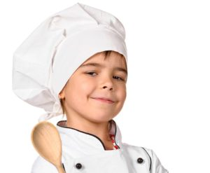 girl chef with wooden spoon isolated on white background